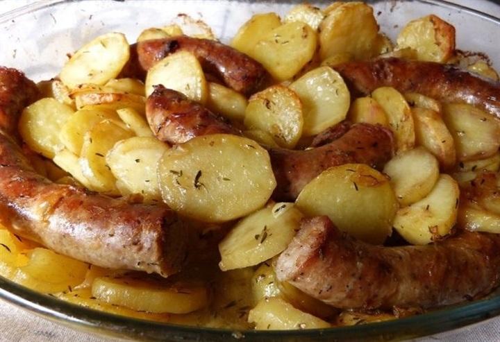 صورة صواني بالفرن سهله , طريقة تحضير صينية البطاطس بالسدق